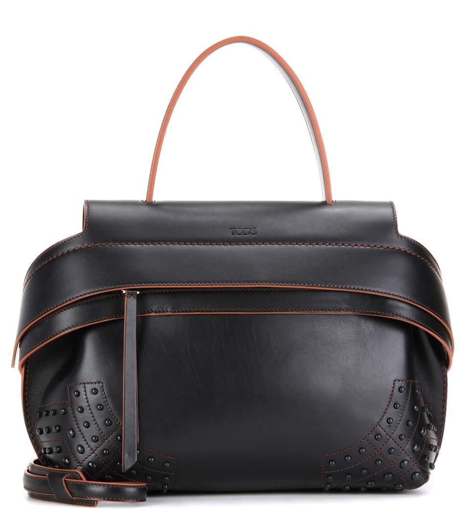 hot-anushka-black-tods-handbag-with-swiveling-straps-american